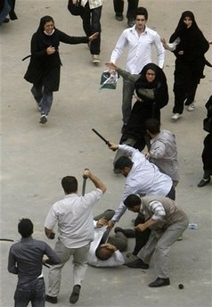 Iran security forces beating participants of a peaceful protest, Hundreds and pehaps thousands of Iranian arrested in Tehran and other major cities in Iran, Government Crack down on Iranian's protesting the election result - Millions of Iranians Protes Iran Presidential Election result - Islamic Republic of Iran Government cracks down on Iranian youth protesting the lack of Freedom and aleged Fraud election result